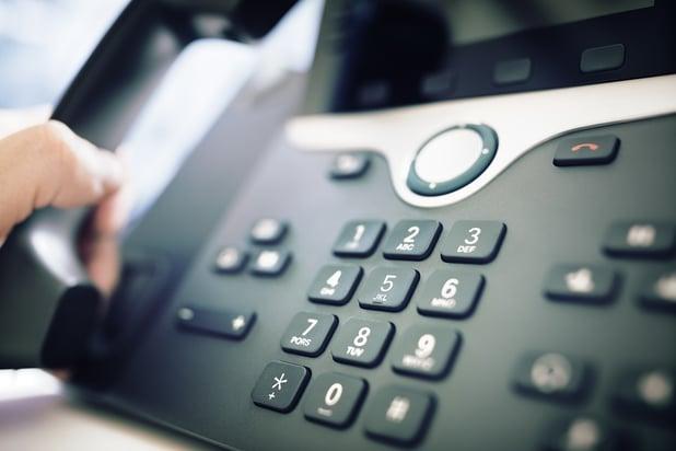 bigstock-Dialing-telephone-keypad-conce-185328370.jpg