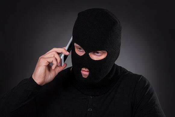 bigstock-Thief-Using-A-Stolen-Mobile-Ph-66703411.jpg