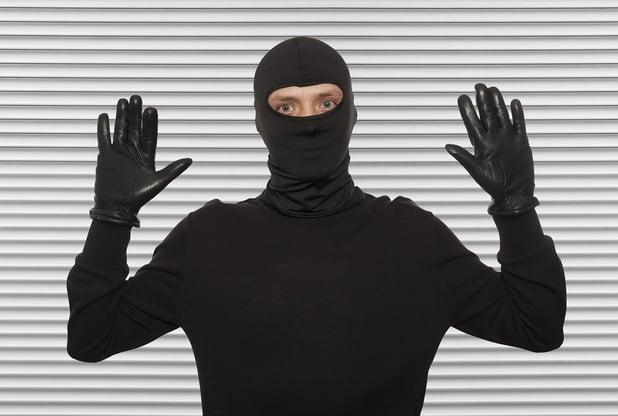bigstock-Thief-with-balaclava-caught-in-104568938.jpg